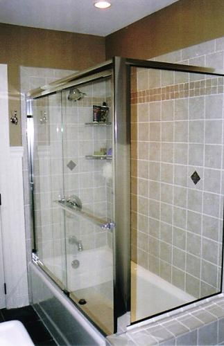 Bypass tub enclosure with return panel
